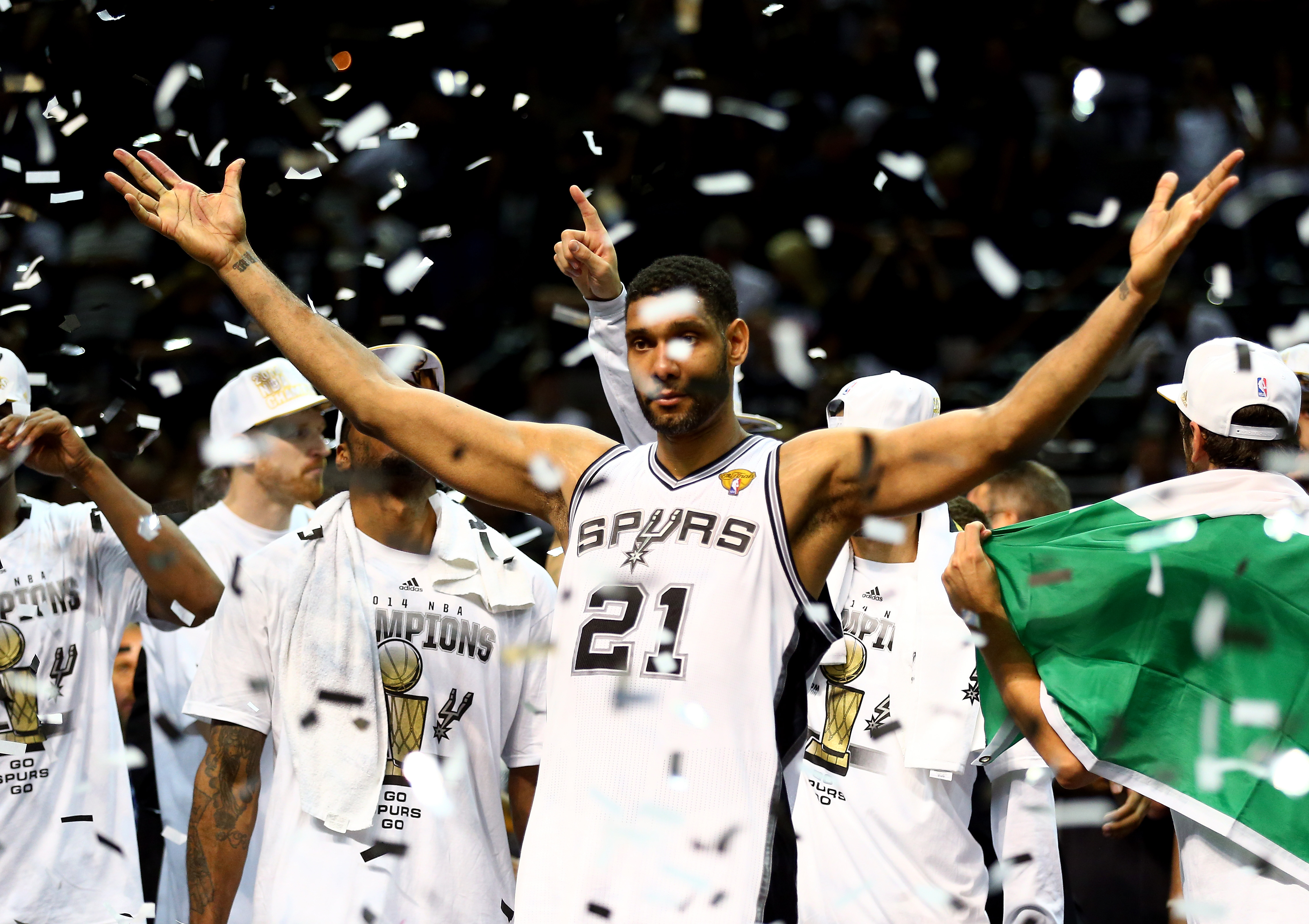 SAN ANTONIO, TX - JUNE 15:  Tim Duncan #21 of the San Antonio Spurs celebrates after defeating the Miami Heat in Game Five of the 2014 NBA Finals at the AT&T Center on June 15, 2014 in San Antonio, Texas. NOTE TO USER: User expressly acknowledges and agrees that, by downloading and or using this photograph, User is consenting to the terms and conditions of the Getty Images License Agreement.  (Photo by Andy Lyons/Getty Images)