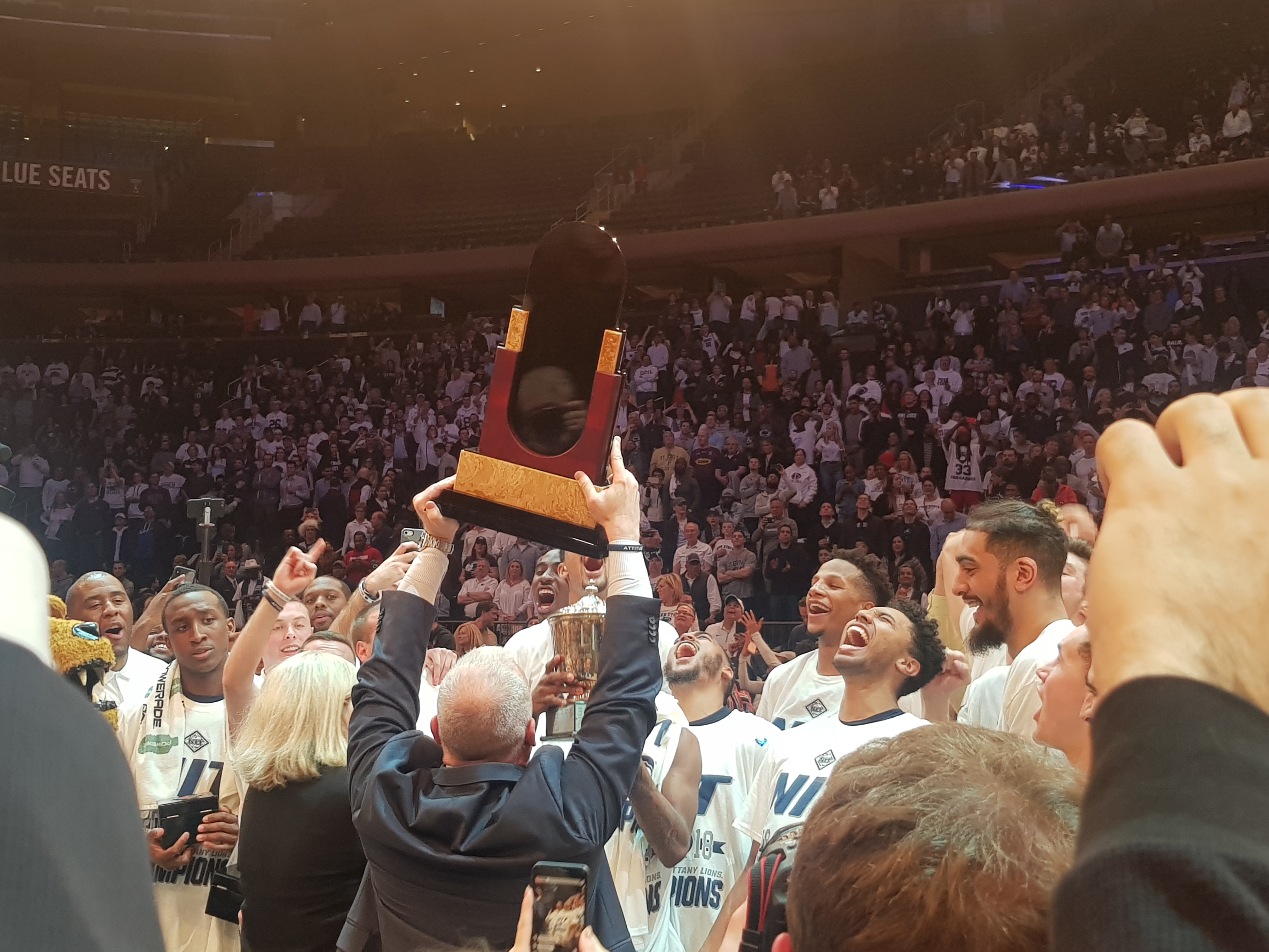 Penn State raising the NIT title Trophy/ DylanA PureSports