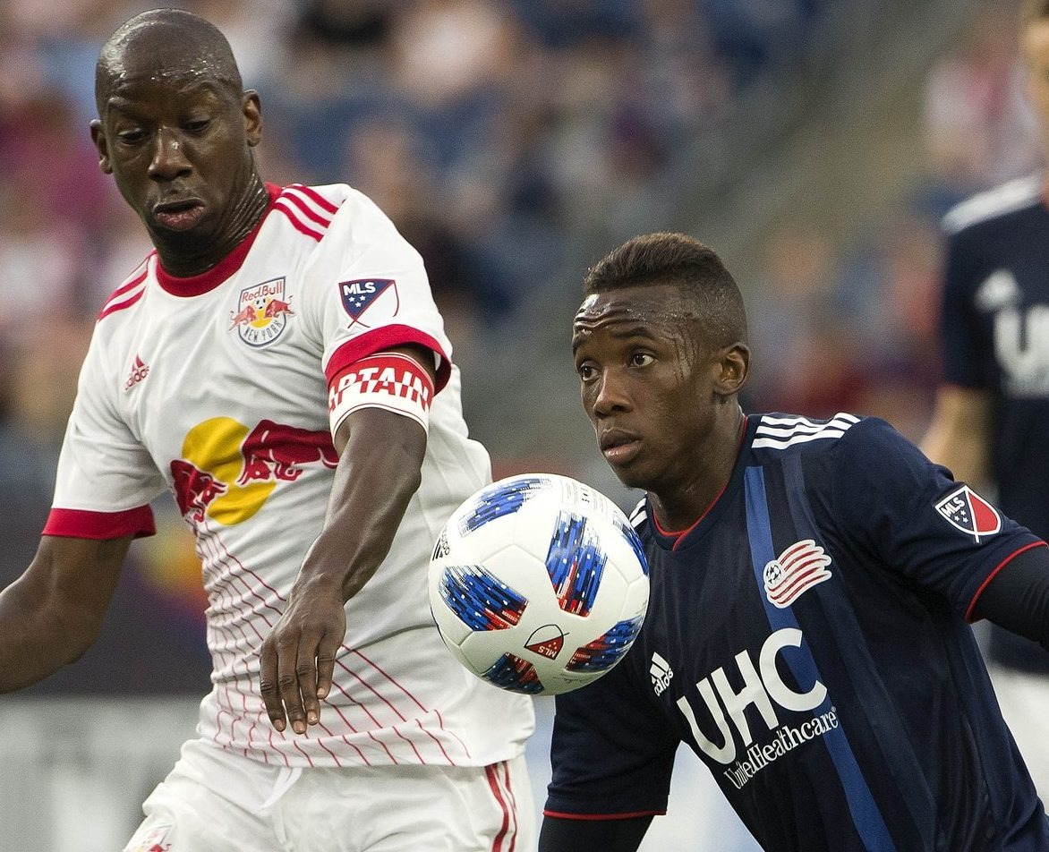 Bradley Wright-Phillips battles for possession against New England on Saturday.  Credit to New York Red Bulls