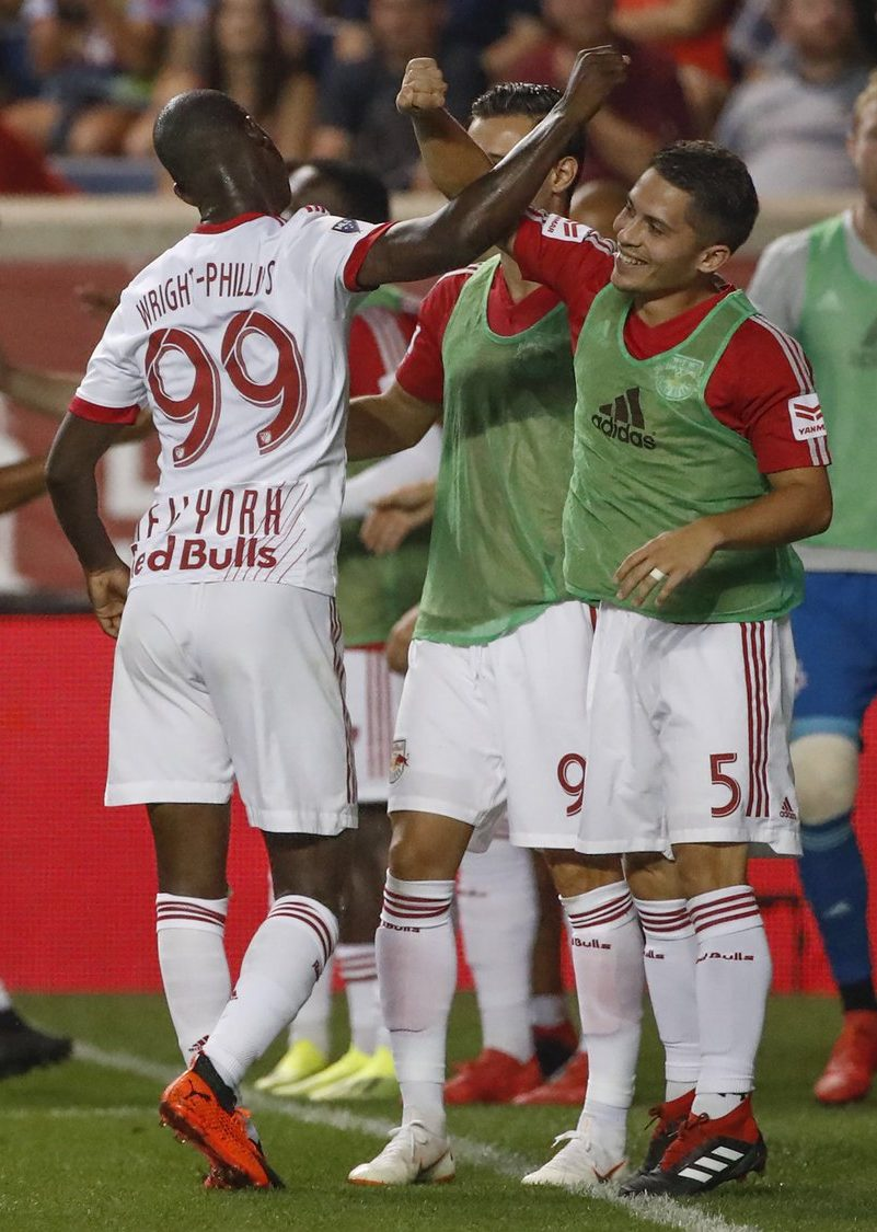Bradley Wright-Phillips celebrates with teammates after scoring the winning goal against the Chicago Fire.  Credit to New York Red Bulls.