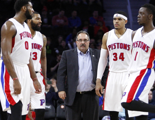 Mar 21, 2016; Auburn Hills, MI, USA; (Left to right) Detroit Pistons center Andre Drummond (0) forward Marcus Morris (13) head coach Stan Van Gundy forward Tobias Harris (34) and guard Reggie Jackson (1) stand during a timeout during the fourth quarter against the Milwaukee Bucks at The Palace of Auburn Hills. Pistons win 92-91. Mandatory Credit: Raj Mehta-USA TODAY Sports