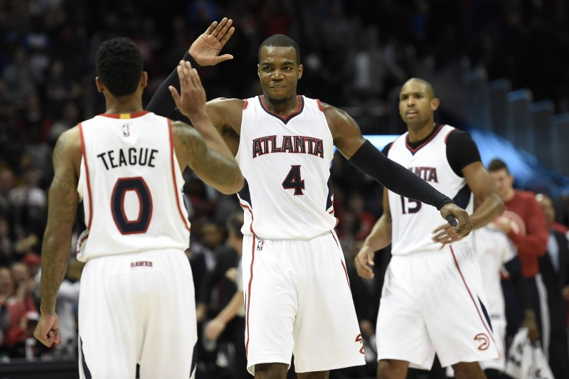 Jan 23, 2015; Atlanta, GA, USA; Atlanta Hawks guard Jeff Teague (0) and forward Paul Millsap (4) react late in the game as the Hawks win their team record 15th consecutive game against the Oklahoma City Thunder at Philips Arena. The Hawks defeated the Thunder 103-93. Mandatory Credit: Dale Zanine-USA TODAY Sports