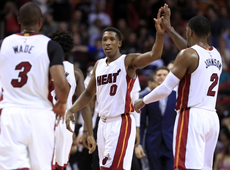 Mar 25, 2016; Miami, FL, USA; Miami Heat guard Josh Richardson (0) celebrates with forward Joe Johnson (2) and guard Dwyane Wade (3) in the second half of a game against the Orlando Magic at American Airlines Arena. The Heat won 108-97. Mandatory Credit: Robert Mayer-USA TODAY Sports